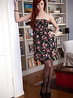 Elle starts in a flowery dress before quickly showing her amazing black stockings