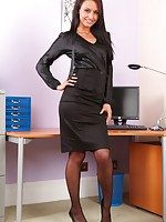 Saucy Sarah teases her way out of her tight black office clothes and reveals sexy black satin lingerie.
